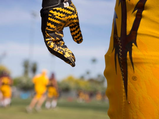 ASU football player Kalen Ballage practices with his