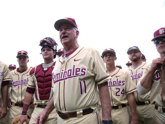 Florida State coach Mike Martin celebrates his 1,900th career win with his team on February 19th, 2017.