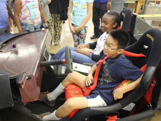 Kids got to sit in an ultra-light car made by engineering