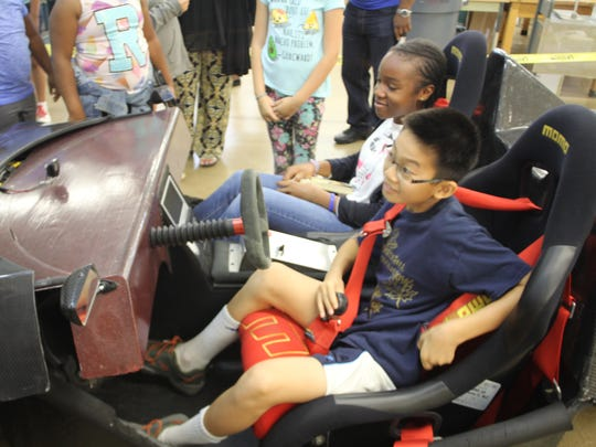 Kids got to sit in an ultra-light car made by engineering students at the FAMU-FSU College of Engineering.