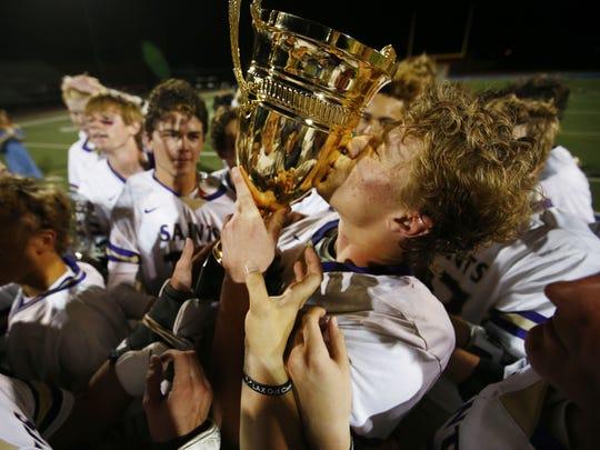 Notre Dame Prep #1 Jake Smith kisses the trophy after