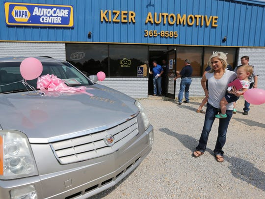 Lauren Ward gets her first look at the Cadillac SRX she won after Ward's Aunt, Melissa Barnes, submitted an essay to the NAPA AutoCare Centers of Northeast Mississippi, in Baldwyn, Miss., that explained why the 20-year-old student and mother should win the car.