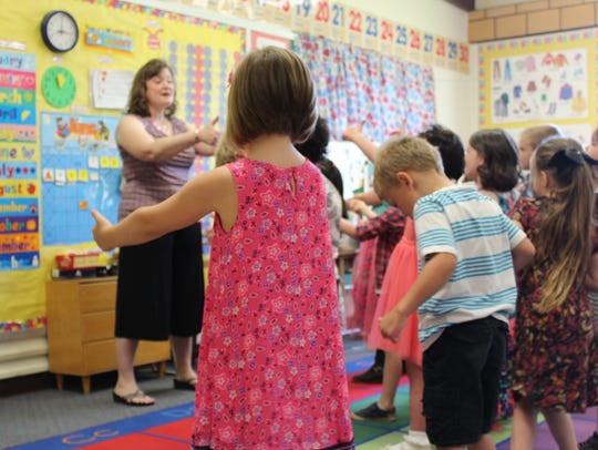 Londa Hart dances with her students before they leave