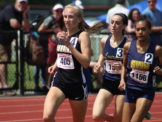 Scenes from Day 2 of the state track and field championships at Union-Endicott: Corning's Jessica Lawson in the 1,500.