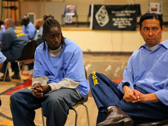 CTF Inmate Dwayne Wheeler, left, listens as murder