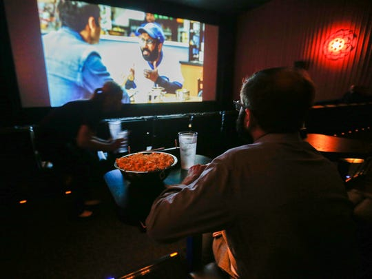 "Servers at Alamo Drafthouse Cinema go into ""ninja mode"" by ducking down to deliver food and drinks during the movie."