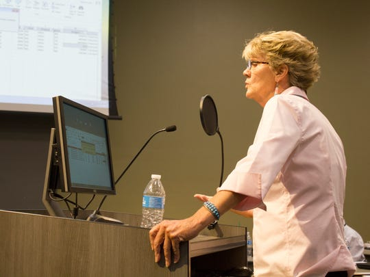 Scottsdale Unified School District's then-Chief Financial Officer Laura Smith presents at a June 20, 2017, governing board meeting.