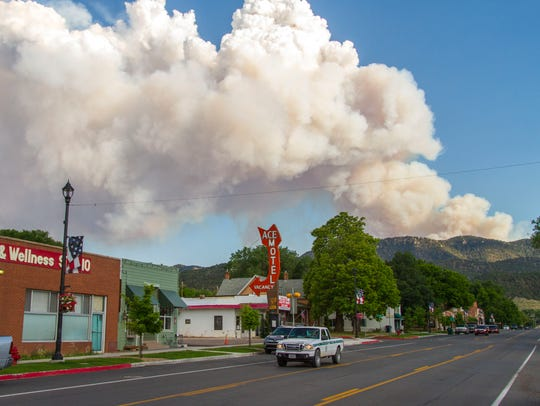 The Brian Head fire is seen from the town of Parowan