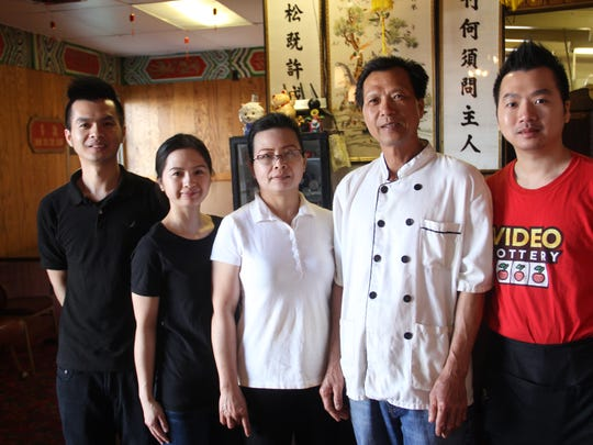 The Feng family poses inside the Happy Dragon. The Feng family worked at Portland dim sum restaurants before moving to Independence in 2013.