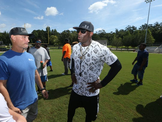 Former FSU and NFL star Deion Sanders meets fans during