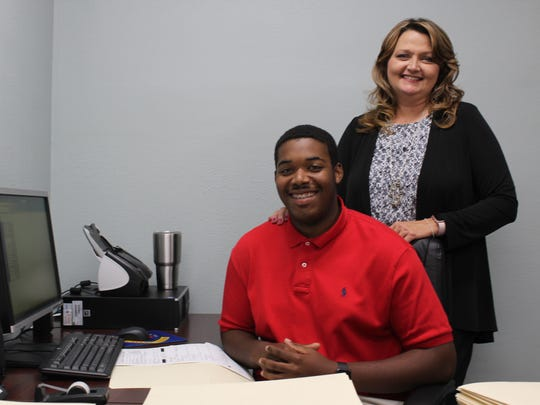 Tyler Thomas, 19, with his mentor through the parish's Summer Youth Work Program.