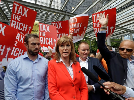 Then-Washington State Republican Party chairwoman Susan Hutchison discusses the Seattle City Council's vote to impose an income tax on the city's wealthiest residents.