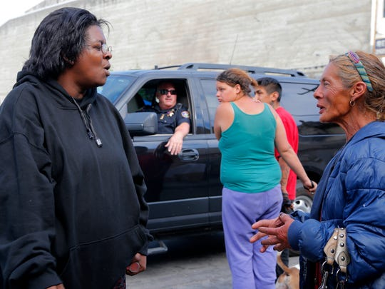 Yolanda Harraway (left) and Salinas Police Cmdr. Dave Crabill (second from left) speak with residents in Chinatown.