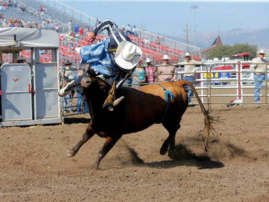 Zach Flatt competes in freestyle bullfights  at the 107th California Rodeo Salinas on Saturday.