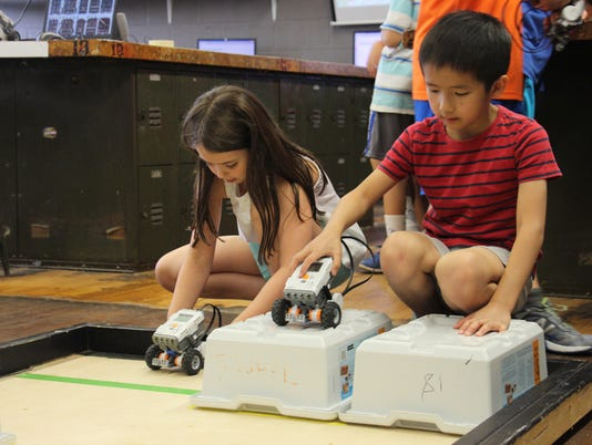 636365817080415903-Girl-and-Boy-with-robot-STEM-Camp.jpg