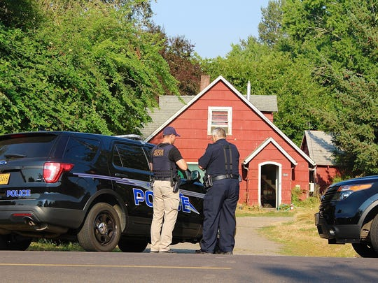 Keizer Police officials respond to the scene of an assault on the 7000 block of Wheatland Road North in Keizer on Friday, August 4, 2017.