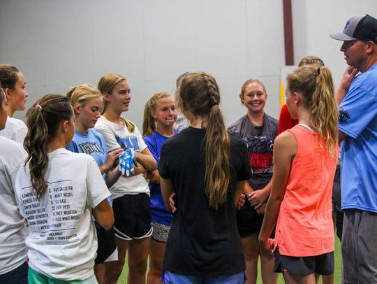 The Cedar National U-12 softball team practices on