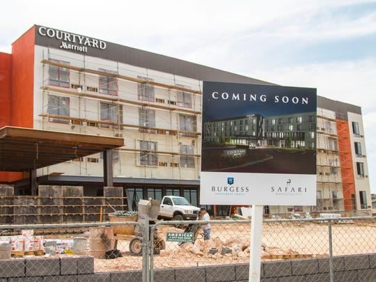 "A ""coming soon"" sign sits on the construction site for the Courtyard Marriott in Cedar City, Thursday, Sept. 7, 2017."