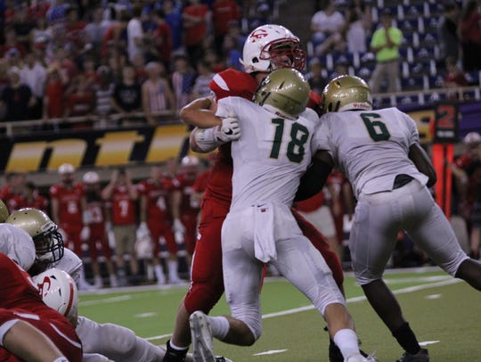 Iowa City West's Cole Mabry (18) and Trumell Roberts