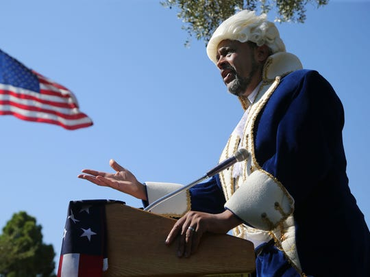 Dressed as George Washington, Sean Carter, a Mesa attorney,
