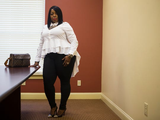 Jermonica Boardley wears a white a.n.a. peplum blouse from JCPenney; Alyx stretch black pants from JCPenney; and black, gold and snakeskin Coach pumps from Macy's.