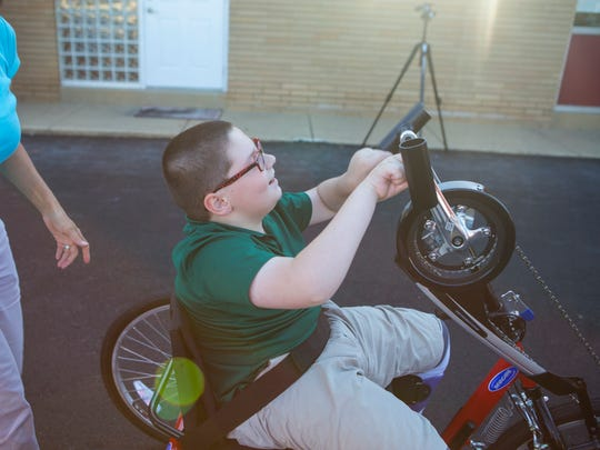 Will Harp starts to get the hang of using his new hand-pedal-powered bicycle.