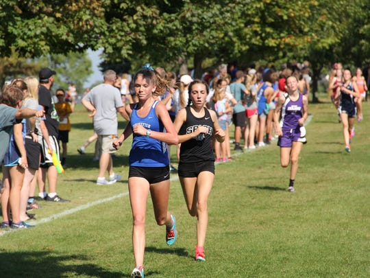 SPASH's Maddie Hyland (right) will compete in the Division 1 girls race after finishing 20th as a freshman last year.