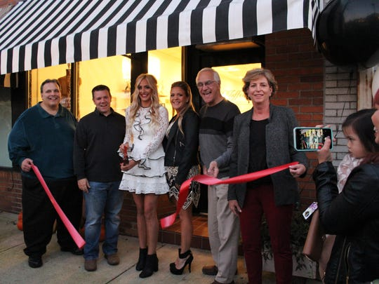 Third Thursday's second ribbon cutting was at Taffeta Hair and Makeup Design. The ceremonial ribbon was cut by owner Alexandra Jenkins. She was joined by manager Gina Bradford (center right) and town officials.