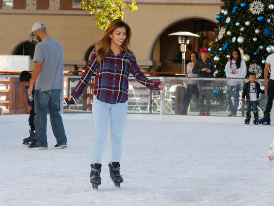 An ice skater enjoys the rink built for WinterFest, which returned to Downtown near the El Paso Museum of Art.