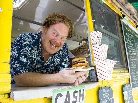 "Casey Webb visits Beansie's bus in Burlington for the Travel Channel show ""Man v. Food."""