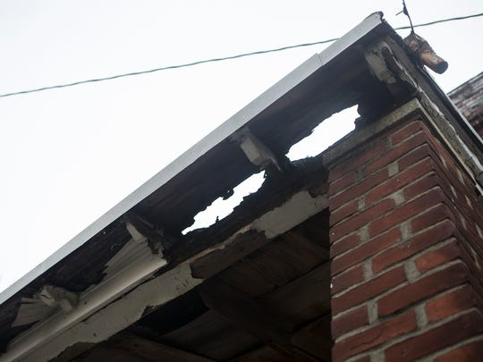 Eroded gutters line the roof of a house in the 1700 block of W. 3rd St. in Wilmington.
