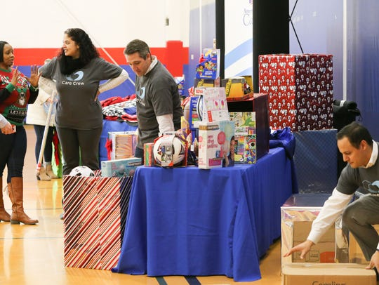 Volunteers from AmeriHealth Caritas deliver toys to the Police Athletic League of Wilmington Thursday.