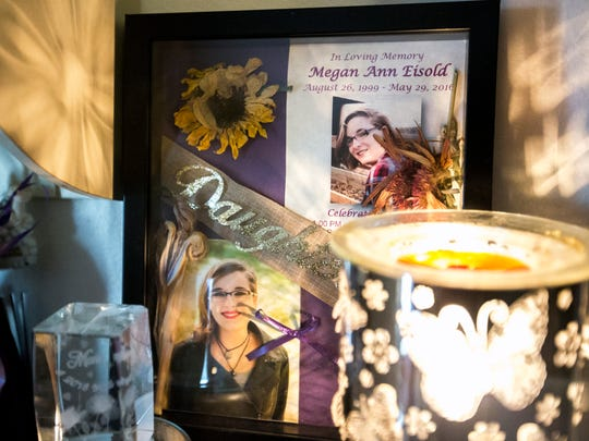 Photos of Megan Eisold and other items are displayed in her mother Missy Ojibway's home in Jim Falls, Wis.