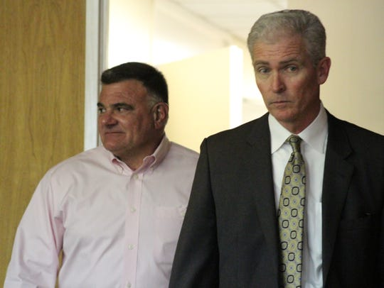 Rapides Parish District Attorney Phillip Terrell (left) and attorney Jimmy Faircloth are shown in the Rapides Parish Police Jury meeting room last year. On Monday, the two announced a deal that would resolve litigation between Terrell's office and the jury. The deal is part of the 2019 budget proposal the district attorney's office submitted to the jury.