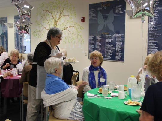 Treasure Health Compliance and Privacy Officer Rivki Beer serves volunteers lunch at the recent Volunteer Appreciation Celebration.