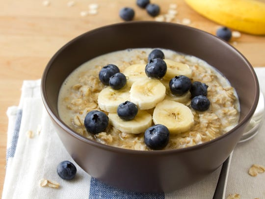 Skipping breakfast can cause you to eat more later in the day. Oatmeal with bananas, blueberries and honey is a healthy option for a morning meal.