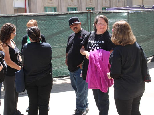 "Animal-rights activists rally outside Monterey County Superior Court Thursday after attending a hearing in the case of Devonte Marquis Sirwet, 22, who allegedly burned his mother's pit bull ""Kato"" so badly it was put down."