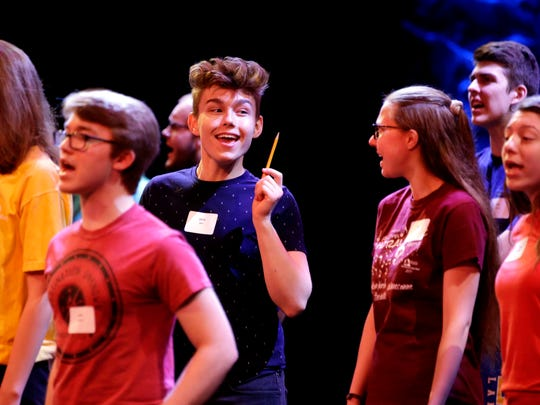 Jacob Breit of Denmark and Emily Bishop of Hortonville take part in rehearsal with other high school students in the Center Stage High School Musical Theater Awards Showcase Saturday, May 19, 2018, at the Fox Cities Performing Arts Center in Appleton, Wis.