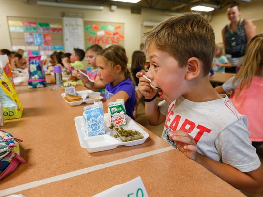 Clark Dale eats lunch during summer school at Harrison
