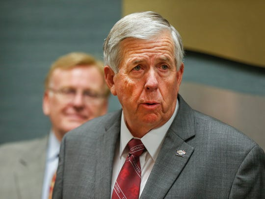 Missouri Governor Mike Parson speaks to the media following