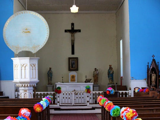 Inside Mission San Juan where mass and church services still remain a part of Lincoln's heritage and tradition