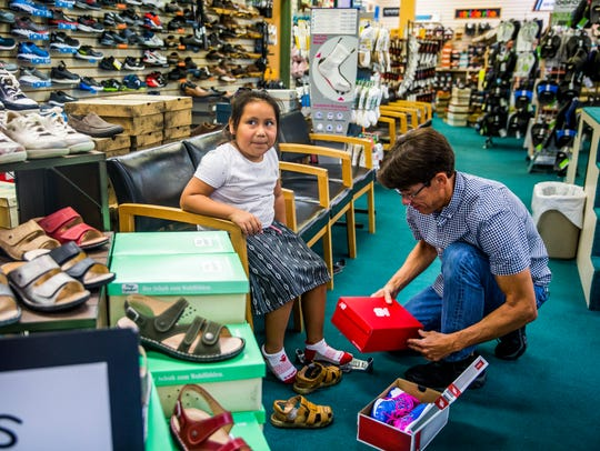 Chris Bossi, store manager, helps incoming second-grader