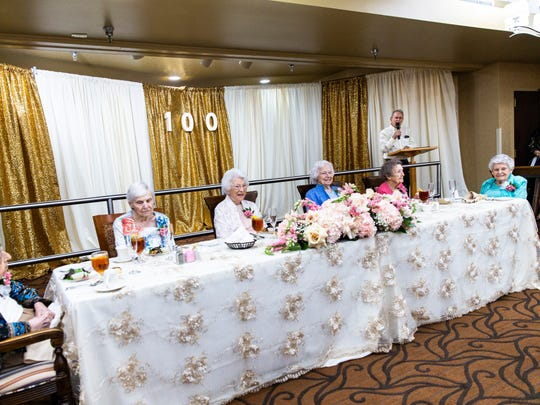 Marion Katzman, 101, from left, Lillian Carey, 102, Merle Harris, 100, Vesta Warner, 100, Claire Connolly, 100, and Helen Crim, 100, listen as Naples Mayor Bill Barnett reads a proclamation naming Wednesday, July 18, 2018, as Centennials of Lely Palms Day during a celebration for the six centenarians at the Lely Palms Retirement Community in East Naples on Wednesday, July 18, 2018.