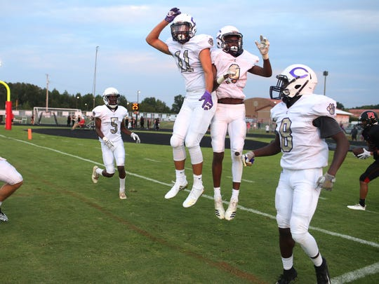 Clarksville's Neko Clark (9) celebrates his touchdown with teammate Devyn Bender (11) during the first game of the season at Rossview High School Friday, Aug. 17, 2018, in Clarksville, Tenn.