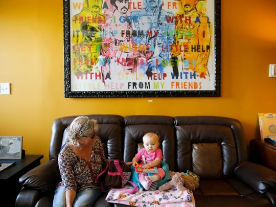 Beth Arcail sits with her granddaughter Elliana Russ Friday, September 8, 2017, at their home in Bethel. Arcial and her husband Joe Arcail, were granted legal custody after her Elliana's mother Stephanie Gaffney overdosed and died this summer.