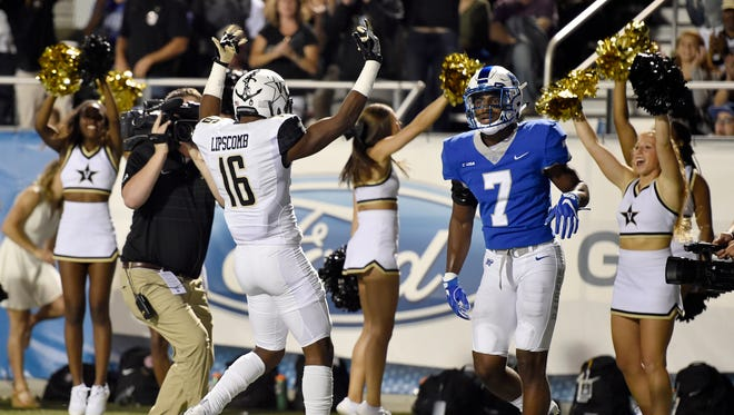 """Vanderbilt wide receiver Kalija Lipscomb (16) celebrates his second touchdown as Middle Tennessee safety Jovante Moffatt (7) walks by during the first half of an NCAA college football game at Johnny """"Red"""" Floyd Stadium in Murfreesboro, Tenn., Saturday, Sept. 2, 2017."""