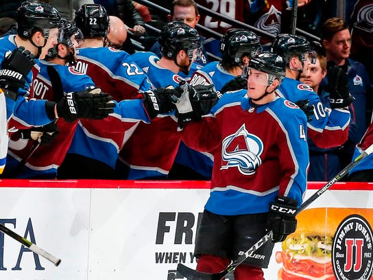 Colorado Avalanche defenseman Tyson Barrie celebrates a goal with teammates on the bench against the St. Louis Blues during the second period of an NHL hockey game Saturday, April 7, 2018, in Denver. (AP Photo/Jack Dempsey)