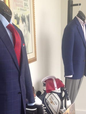 Displayed in the show window at Weiss & Goldring are the outfits the U.S. team members will wear at the opening (left) and closing (right) ceremonies for the Presidents Cup which starts Oct. 8 at Inchon City in South Korea.