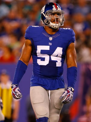 Olivier Vernon of the New York Giants during the first half against the Miami Dolphins in an NFL preseason game at MetLife Stadium on August 12, 2016 in East Rutherford, New Jersey. The Dolphins defeated the Giants 27-10.