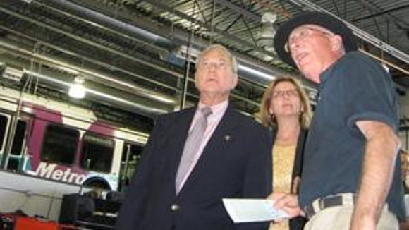 "Then U.S. Rep. Harry Mitchell touring a ""green"" business as part of his green jobs outreach effort in 2009."